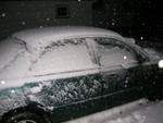 snowy car at night